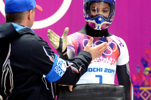 U.S. Army World Class Athlete Program and U.S. Olympic skeleton coach Sgt. 1st Class Tuffy Latour (left) and Noelle-Pikus Pace slap hands before she wins the Olympic silver medal in women's skeleton Feb. 14 at the Sanki Sliding Centre in Krashnaya Polyana, Russia, one of several sites of the Sochi 2014 Olympic Winter Games. (U.S. Army photo by Tim Hipps, IMCOM Public Affairs.)