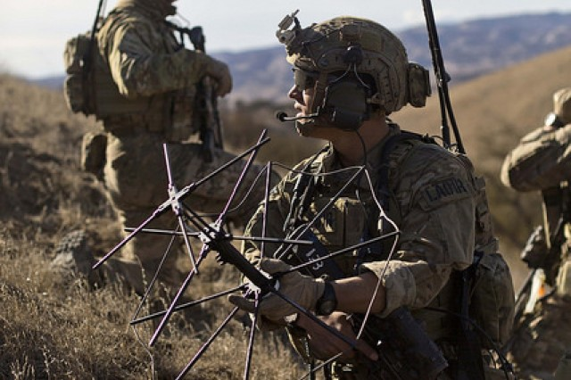 A U.S. Army Ranger assigned to 2nd Battalion, 75th Ranger Regiment, transmits information during Task Force Training on Camp Roberts, Calif., Jan. 31, 2014. Rangers constantly train to maintain their technical proficiency.