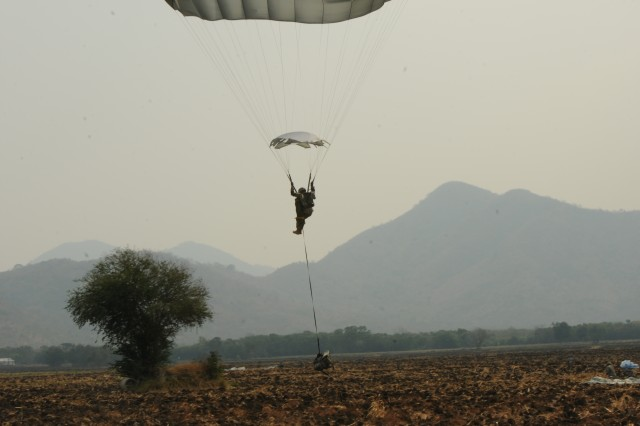 A paratrooper with the 4th Infantry Brigade Combat Team (Airborne), 25th Infantry Division, prepares to conduct a parachute-landing fall into Lop Buri, Kingdom of Thailand, after traveling from Alaska, with approximately 400 paratroopers and 20 Royal Thai Armed Forces liaisons, Feb. 14, 2014, as part of Exercise Cobra Gold 2014. Now in its 33rd iteration, Cobra Gold demonstrates the strong bond that has existed between the U.S. and Kingdom of Thailand for the past 180 years.