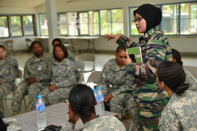 Lt. Col. Salawati Yahaa, an officer from the Malaysian Joint Force Headquarters, shared her experience with prioritizing and balancing from the perspective of being both a mother of four while continuing to serve her country at the first international Sisters in Arms during Cobra Gold 2014.