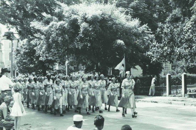 A company of Women's Army Corps members, both black and white, march in formation down Sycamore Street in Petersburg in the summer of 1951. The installation became the first permanent home of the WACs School in 1948 and became fully integrated by 1950. (U.S. Army Women's Museum)
