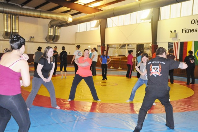 Participants drill their new moves at Linda Vu's self-defense seminar in Hohenfels, Feb. 13.