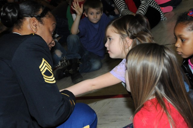 Master Sgt. Samantha Weatherspoon, Army Contracting Command and Sgt. Audie Murphy Club member, speaks to a group of Wilson Elementary students during a community outreach event at the school in Davenport, Iowa, Feb. 14. (Photo by Sgt. 1st Class Shannon Wright, ASC Public Affairs)