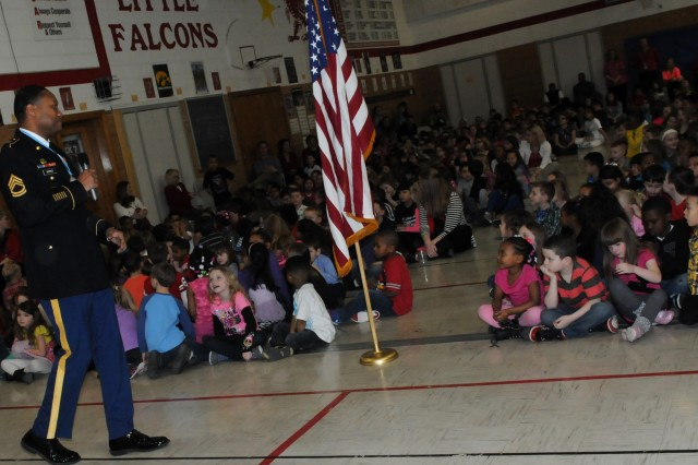 Sgt. 1st Class Darrick Dupree, Army Sustainment Command and Sgt. Audie Murphy Club member, speaks to about 550 elementary students at Wilson Elementary School, Davenport, Iowa, Feb. 14. (Photo by Sgt. 1st Class Shannon Wright, ASC Public Affairs)