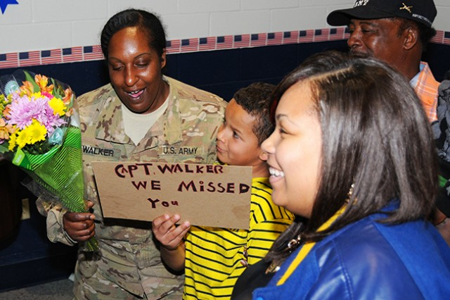 Capt. Francena Walker, 164th TAOG, hugs members of her Family as they line up to welcome her home from a nearly six-month deployment in Afghanistan and Kuwait at the Spiritual Life Center Feb. 17. Close to 20 Soldiers were welcomed home along with Walker.