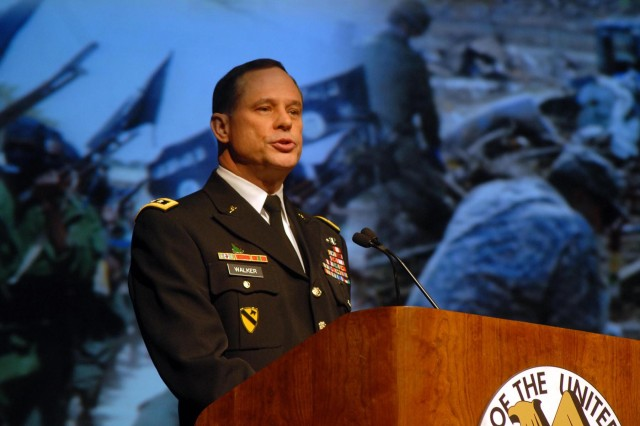 """Lt. Gen. Keith Walker, deputy commanding general, futures director, Army Capabilities Integration Center, Army Training and Doctrine Command, speaks on """"The Operational Environment in 2025"""" at the AUSA Winter Symposium in Huntsville Wednesday."""