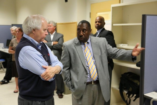 Dr. Thomas Davis, chief of the Weapons Branch within ARL's Human Research and Engineering Directorate at Redstone Arsenal, Ala., stands in the Manned/Unmanned Collaborative Systems Integration Laboratory with Robert A. Altenkirch, president of the University of Alabama in Huntsville.