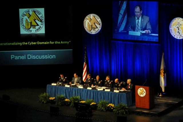 "Panelists discuss ""Operationalizing the Cyber Domain for the Army"" at the AUSA Winter Symposium Thursday in Huntsville. Ala. Panelists included: Lt. Gen. Mark Bowman, director for command, control, communications and computer/cyber/chief information officer, J-6, Joint Staff; Maj. Gen. Thomas James Jr., director, Mission Command Center of Excellence, Army Training and Doctrine Command; Col. Maureen O'Connor, director, Army Joint Force Headquarters - Cyber, Army Training and Doctrine Command; Lt. Col. Paul Stanton, technical liaison to USCYBERCOM, Army Cyberspace Command; and Robert Fecteau, chief information officer, SAIC. The panel was moderated by retired Lt. Gen. Jeff Sorenson and chaired by Lt. Gen. Edward Cardon, commanding general, Army Cyberspace Command."