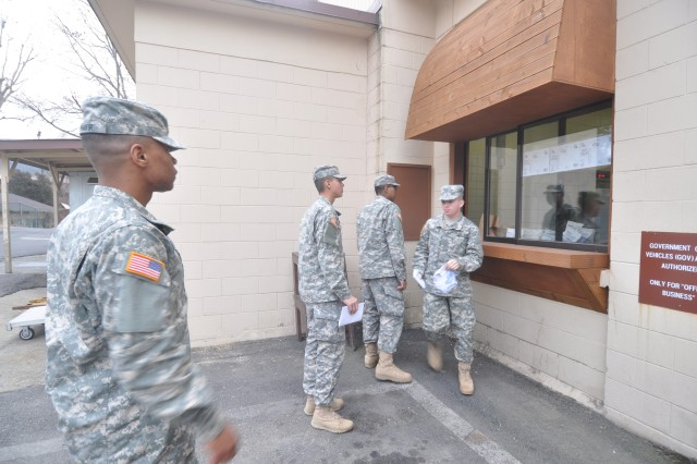 Soldiers wait in line to get a to-go bag for breakfast using the to-go window, Feb 5. (U.S. Army photo by Pfc. Jung Young Ho)
