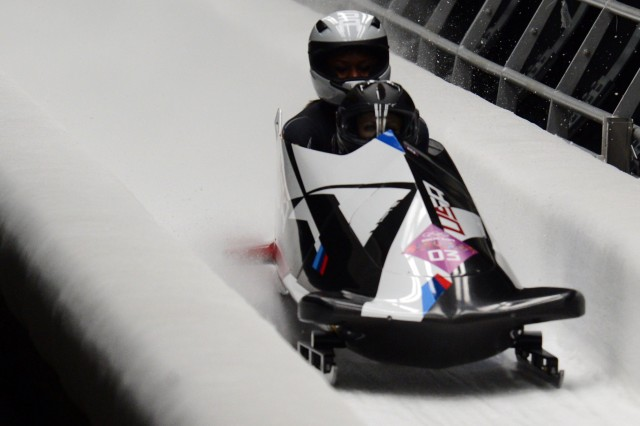 USA's Jamie Greubel and Aja Evans cross the finish line with a combined four-run time of 3:51.61 to win an Olympic bronze medal, Feb. 19, 2014, at Sanki Sliding Center in Krasnaya Polyana, Russia.