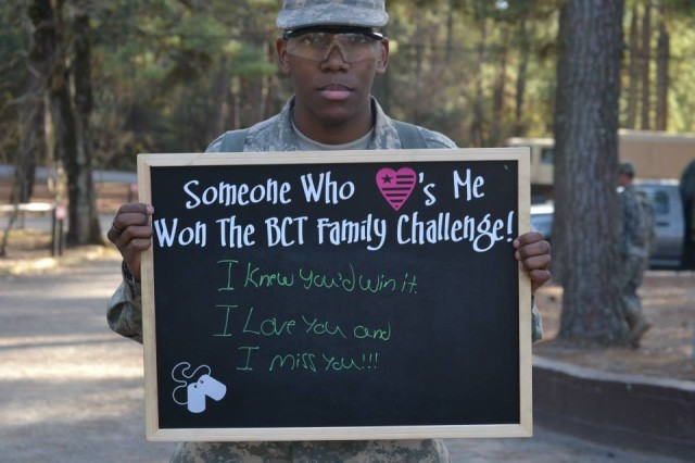 A Soldier in Basic Combat Training at Fort Jackson poses with the BCT Family Challenge chalkboard. The photo was posted on the 2nd Battalion, 13th Infantry Regiment's Facebook site as a reward to a family member who participated in the Army Family Team Building program online.