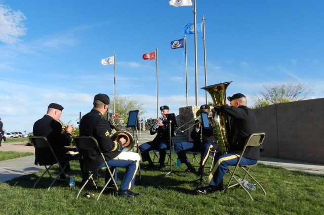 The Military Intelligence Corps Band�'s brass quintet performs during an evening Memorial Day ceremony in the Southern Arizona Veterans�' Memorial Cemetery. The band often performs in small ensembles focusing on a particular genre of music.