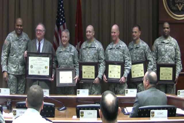 From left, Maj. Gen. Leslie Smith, Maneuver Support Center and Fort Leonard Wood commanding general; David Dunstedter, MSCoE Quality Assurance Office chief; Col. Bjarne Iverson, MSCoE chief of staff; Brig. Gen. Anthony Funkhouser, U.S. Army Engineer School commandant; Brig. Gen. Mark Spindler, U.S. Army Military Police School commandant; Col. Jeffrey Brodeur, U.S. Army CBRN School assistant commandant; and Command Sgt. Maj. Curtis Johnson, Noncommissioned Academy, hold accreditation certificates.The U.S. Army Engineer and Military Police schools, as well as the MSCoE staff, retained their full accreditation status, while the Chemical, Biological, Radiological and Nuclear School was awarded an Institution of Excellence rating.