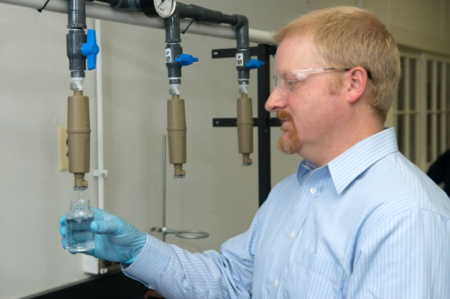 Art Lundquist, Drinking Water and Sanitation Program environmental engineer, tests individual water purifiers to determine whether they meet Army requirements.