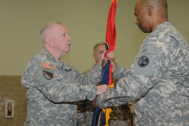 Lt. Col. (P) Michael L. Bland relinquishes command of 1st Brigade, 94th Training Division by handing the brigade colors to Brig. Gen. Don S. Cornett, commander 94th Training Division, during a Change of Command Ceremony at the brigade headquarters in Charleston, W. Va., Feb. 22, 2014. Col. Timothy D. Dye succeeded Bland as the commander.