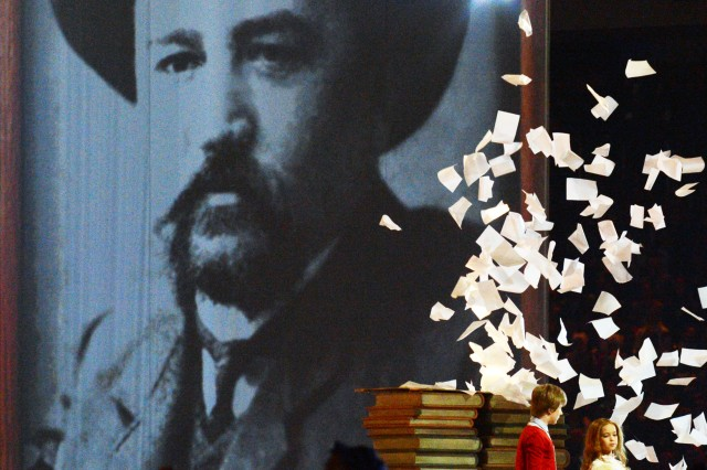 Russian author Anton Chekhov was one of 12 famous writers honored at the Closing Ceremony of the Sochi 2014 Olympic Winter Games, Feb. 23, 2014, in Fisht Stadium in Sochi, Russia. Here in the library scene, a powerful whirlwind sweeps the pages of literature into a swirling vortex.