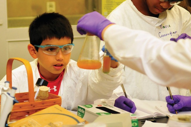 Students participate in the 2011 GEMS program at the Walter Reed Army Institute of Research, Silver Spring, MD. GEMS is geared to students in middle and high school, exposing them to engineering, robotics, biology, chemistry and geology.