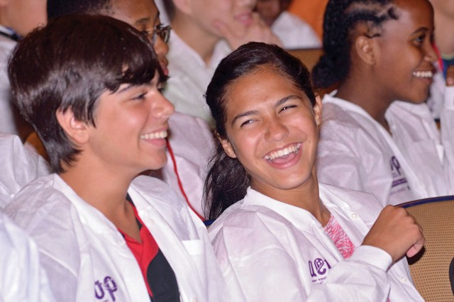 Student participants in the AEOP programs Gains in the Education of Mathematics and Science (GEMS), Science and Engineering Apprentice Program (SEAP) and College Qualified Leaders (CQL) enjoy a closing ceremony in September 2013 at Georgetown University in Washington, D.C.. Co-sponsoring the event were the Walter Reed Army Institute of Research and 100 Black Men of Greater Washington, D.C..
