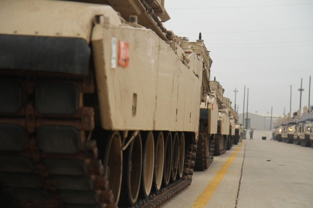 Newly acquired tanks line the Fort Hood rail head Feb. 19. Soldiers assigned to 1st Battalion, 9th Cavalry Regiment, 2nd Brigade Combat Team, 1st Cavalry Division, received vehicles from the 4th Infantry Division based in Fort Carson, Colo., as part of the reorganization of units within the Army. (U.S. Army photo by Sgt. Angel Turner, 1st Cav. Div. PAO (Released)