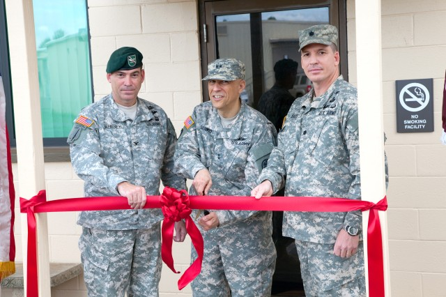 Maj. Gen. Dean Sienko (center), commander, USAPHC; along with Col. Daniel Whitney (left), commander, USAG-HI; and Lt. Col. Kevin Bass, commander for Hawaii�'s VTFs, perform the ribbon-cutting ceremonies for the upgraded and renovated Schofield Barracks VTF facility, Tuesday. The facility now is upgraded to Level II status.