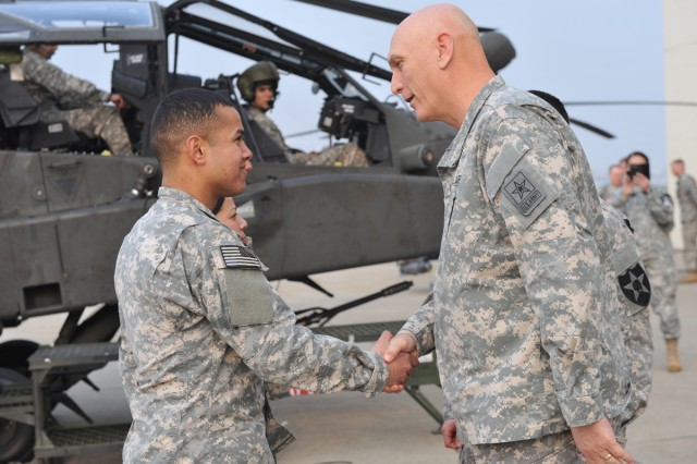 U.S. Army Chief of Staff Gen. Ray Odierno (right) visits South Korea, Feb. 23-25, 2014, where he thanked U.S. troops and praised his South Korean allies.