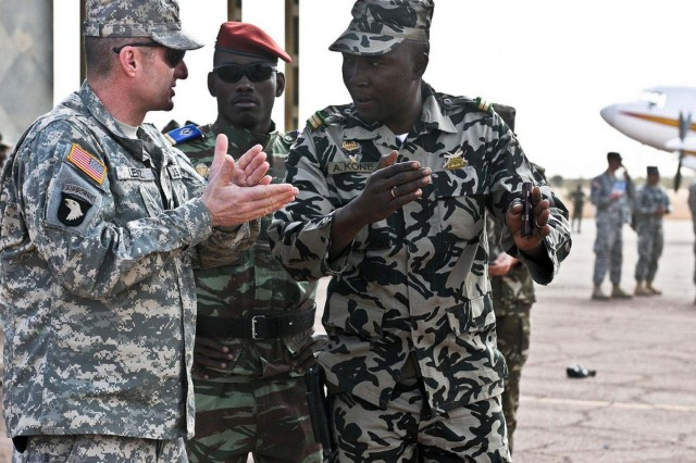 New York Army National Guard Command Sgt. Maj. Justin Lenz, speaks with Malian Army Lt. Abdrahmane Kone during the 369th Sustainment Brigade's deployment to Mali in 2012. The battalion returns to Africa in March to serve as a logistics headquarters for Central Accord 14, a joint exercise being held in Cameroon. This will be the third African exercise the brigade has played a role in. (U.S. Army photo by Staff Sgt. Shana R. Hutchins)