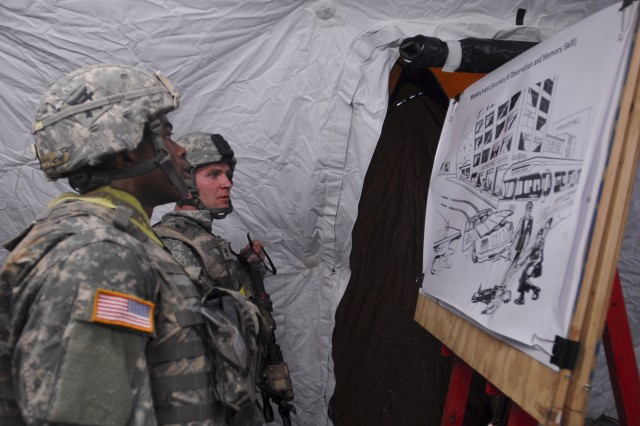 "FORT CAMPBELL, Ky. �"" 1st Lt. Andre Shinda (foreground) and Staff Sgt. Robert Herendeen from 3rd Battalion, 187th Infantry Regiment, 3rd Brigade Combat Team �""Rakkasans,"" 101st Airborne Division (Air Assault), study a scene during the mystery event of the �'Best Rakkasan�' competition here Feb. 20, 2014. The competition tested the two-Soldier teams mentally and physically over two days in a series of eight events to determine the Brigade�'s premiere Soldiers. (Photo by Staff Sgt. Joel Salgado, 3rd Brigade Combat Team Public Affairs)"
