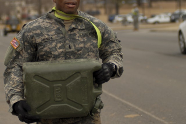 "FORT CAMPBELL, Ky. �"" 1st Lt. Andre Shinda from Company D, 3rd Battalion, 187th Infantry Regiment, 3rd Brigade Combat Team �""Rakkasans,"" 101st Airborne Division (Air Assault), carries a five-gallon water jug during the final event of the �'Best Rakkasan�' competition here Feb. 20, 2014. The competition tested the two-Soldier teams mentally and physically over two days in a series of eight events to determine the Brigade�'s premiere Soldiers. (Photo by Staff Sgt. Joel Salgado, 3rd Brigade Combat Team Public Affairs)"