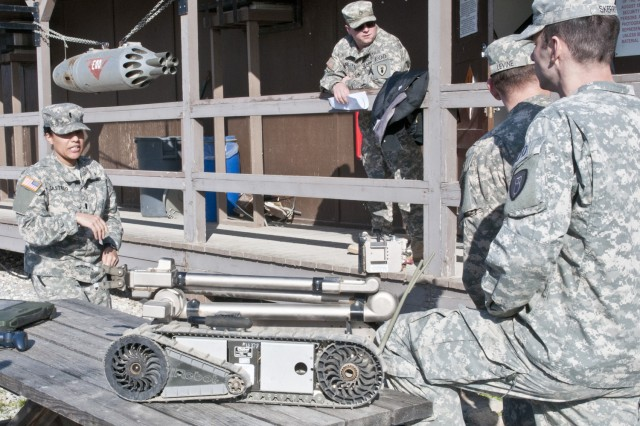 1st Lt. Janill Castillo, a native of Bronx, N.Y., supervises training with her Soldiers at the EOD detachment on Camp Bondsteel, Feb 25. The 26-year-old's job is part of a few careers that already have females serving on the frontlines of combat.