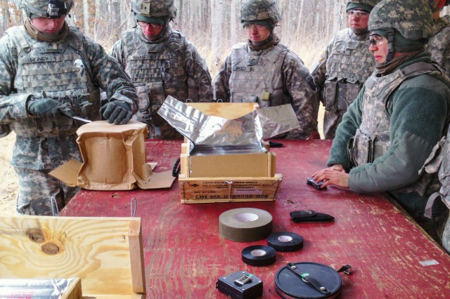 "FORT CAMPBELL, Ky. �"" Sgt. Jason Heiney(Left),a noncommissioned officer assigned to 591st Engineer Company, 3rd Special Troops Battalion, 3rd Brigade Combat Team �""Rakkasans,"" 101st Airborne Division (Air Assault), teaches Soldiers within his company how to prepare explosives on a range here, Jan. 24, 2014. The 591st joined the Rakkasans in January 2014 and have already spent a great deal of time at ranges to enhance their skill sets as combat engineers. (Courtesy Photo)"