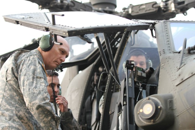 Chief of Staff of the Army Gen. Raymond T. Odierno tours the inside of an AH-64 Apache helicopter, during his visit to 4th Attack Reconnaissance Squadron, 6th Calvary Regiment, 2nd Combat Aviation Brigade, 2nd Infantry Division, Hangar on Camp Humphreys, South Korea, Feb. 24, 2014. The CSA received a tour of various aviation equipment and aircraft used by 4-6 ARS Soldiers during his visit to Camp Humphreys.