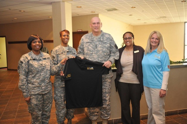 U.S. Army Chief of Staff Gen. Ray Odierno is presented with a personalized Army Strong SHARP polo shirt by (Right to Left) Barbara A. Archer, Sexual Harassment/Assault Response and Prevention victim advocate for 1st Signal Brigade, Daphne E. Givens, SHARP program Sexual Assault Response Coordinator, USAG Yongsan Garrison, Cindy L. Williams, SHARP program SARC for 501st Military Intelligence Brigade  and Master Sgt. Erica D. Williams, SHARP program SARC for 1st Signal Brigade Soldiers in the South Post Chapel, USAG Yongsan, South Korea on February 25, 2014.