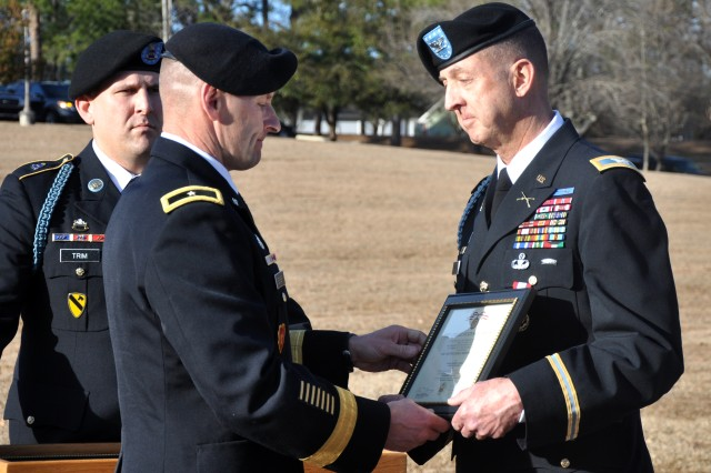 Brig. Gen. Bradley Becker, left, Fort Jackson's commanding general, congratulates Col. Stephen Yackley on his 41 years of service during Yackley's retirement ceremony Feb. 21 at Fort Jackson's Victory Field.