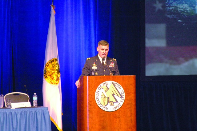 Lt. Gen. David L. Mann, commanding general, U.S. Army Space and Missile Defense Command/Army Forces Strategic Command, speaks at the 2014 Association of the U.S. Army Winter Symposium and Exposition at the Von Braun Center in downtown Huntsville, Ala., Feb. 20.
