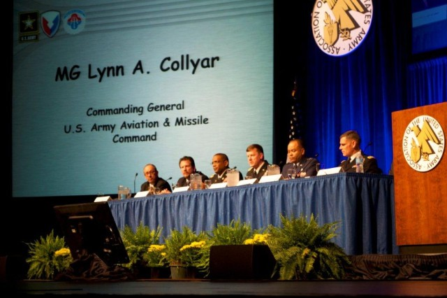 Maj. Gen. Lynn Collyar, U.S. Army Aviation & Missile Command, fourth from left, delivers the command's position about logisticians leveraging space to assure mission-command functions.