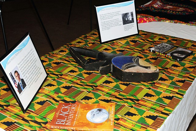 Pieces of art from black history are displayed at the Rock Island Arsenal Black History Month observance in Heritage Hall at Rock Island Arsenal, Ill., Feb. 26. (Photo by Sgt. 1st Class Shannon Wright, ASC Public Affairs)