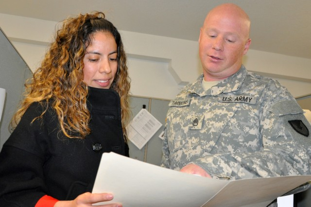 Natalia Lerma and Staff Sgt. David Timmons go over a purchase request at Fort Bliss, Texas. Lerma and Timmons are contracting specialists at the Mission and Installation Contracting Command-Fort Bliss office.