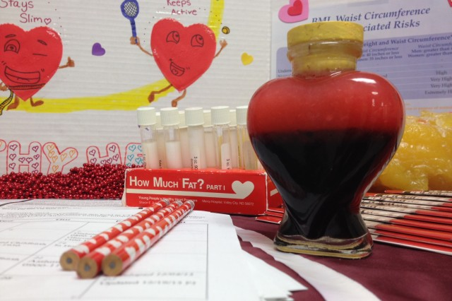 The heart-shaped bottle contains the approximate amount of fat consumed in a day on a 2,200 calorie diet, and is one of several informative items on display at the hospital's Community Health Resource Center throughout February, National Heart Health Month.