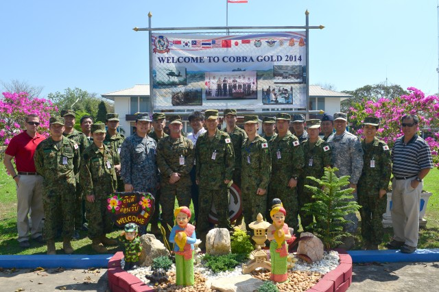 PHITSANULOK, Thailand - The Japan Ground Self-Defense Force Humanitarian Aid/Disaster Relief team at Exercise Cobra Gold 2014 pose for a group photo. (photo by Sgt. 1st Class Crista Mary Mack, USARPAC Public Affairs)