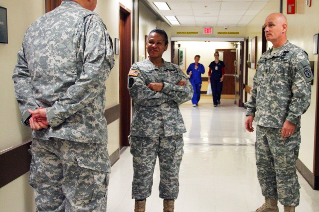 Command Sgt. Maj. Donna A. Brock, command sergeant major for U.S. Army Medical Command receives a Tripler Army Medical Center (TAMC) facilities and capabilities brief from Command Sgt. Maj. Robert C. Luciano, command sergeant major for Pacific Regional Medical Command and TAMC and Sgt. Maj. Edward D. Leonard, Chief Clinical NCO for TAMC during a visit on February 25, 2014.