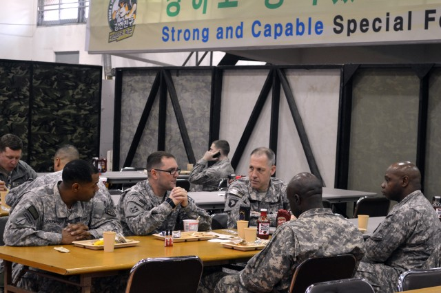 The 1st Signal Brigade command team including Brigade Commander, Col. Paul H. Fredenburgh III, Command Sgt. Maj. Darris Curry and Chief Warrant Officer 4 Roy Rucker, Command Chief Warrant Officer, discuss the 2014 Key Resolve exercise over breakfast with Maj. Rett B. Burroughs, director of joint communications for Special Operations Command-Korea, and Capt. Donald K. Colemon, joint communications operations officer, SOCKOR, at Republic of Korea Army Special Forces Command, Songpa, South Korea on Feb. 24, 2014. (U.S. Army Photo by KATUSA Cpl. Oh Jong Soo)