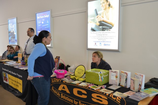 Lauren Tankersley, right, from Family Advocacy, talks to Desiree Padilla during the Relocation Showcase at U.S. Army Garrison Ansbach's Urlas Shopping Center Feb. 27, 2014.