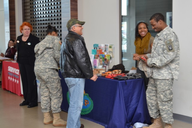 Community members interact with the representatives of the Army Substance Abuse Program during the Relocation Showcase at U.S. Army Garrison Ansbach's Urlas Shopping Center Feb. 27, 2014.