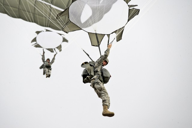 U.S. Army Staff Sgt. Joshua Livingston (front), a paratrooper assigned to 4th Battalion, 319th Airborne Field Artillery Regiment, 173rd Infantry Brigade Combat Team (Airborne) conducts a training jump during an airborne operation at the 7th Army Joint Multinational Training Command's Grafenwoehr Training Area, Germany, Feb. 20, 2014.
