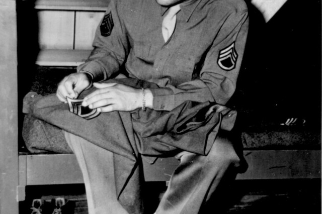 World Heavyweight champ Joseph Louis Barrow (aka Joe Louis) sews on the stripes of a technical sergeant, to which he has been promoted on April 10, 1945