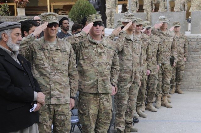 """KUNAR PROVINCE, Afghanistan �"""" U.S. Army leaders from Regional Command-East render honors during the playing of the national anthem at Forward Operating Base Wright before the official Transfer of Authority between the 3rd Squadron, 89th Cavalry Regiment, and 1st Squadron, 75th Cavalry Regiment on Feb. 27, 2014. 3rd Squadron is a part of 4th Brigade Combat Team, 10th Mountain Division, Task Force Patriot. (U.S. Army photo by Spc. Eric Provost, Task Force Patriot PAO)"""