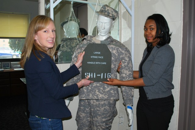 Researchers from the U.S. Army Research Laboratory continue to expand body armor analysis work to protect Soldiers not only protecting their lives, but also their daily life functions after treatment and recovery. Shown here is Rebecca VanAmburg (left), who is assisted by Latrice Hall (right), determining the proper placement of hard armor on a Soldier mannequin.