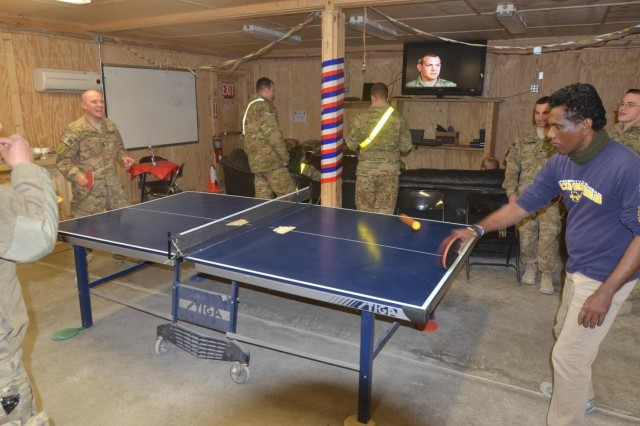 "Soldiers and civilians alike enjoyed ping pong and movies during the ""First Cup"" New Year's Eve party at Kandahar Airfield, Afghanistan Dec. 31. (U.S. Army photo by Capt. Andrew Cochran/released)"