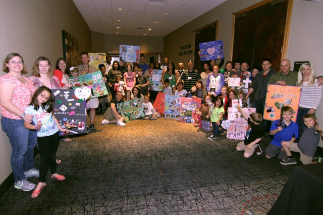 Arizona Guardsmen and their families participate in the Family Strong Bonds event Feb. 22 at the Hyatt Regency in Phoenix, Ariz. Families created collages that represent what their family is about. (U.S. Army National Guard photo by Sgt. Adrian Borunda/Released)