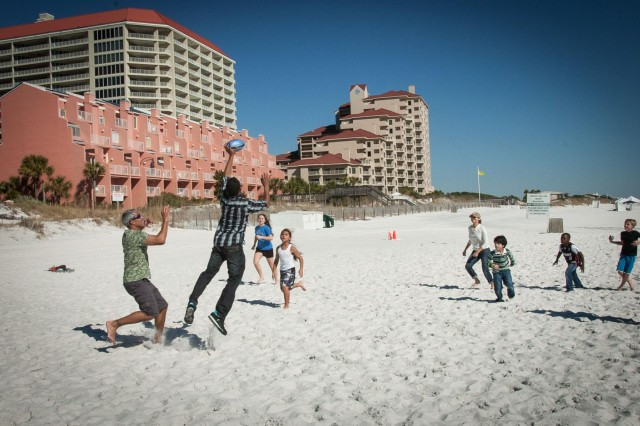 "Soldiers and family members of the 7th Special Forces Group (Airborne) participate in a beach obstacle course as part of a Strong Bonds program held Valentine's Day weekend at the Sandestin Resort in Destin, Fla.  The marriage retreat focused on Dr. Gary Chapman's concept of families using ""Love Languages"" to communicate and resolve problems better."